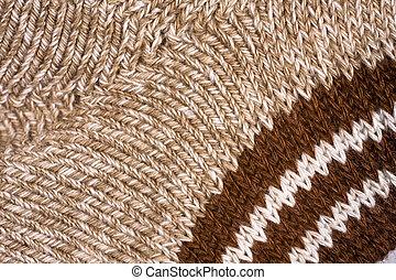 Stockinette of yellow melange mohair yarn as background