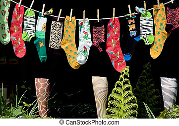 Stockings - A bunch of brightly colored stockings hanging on...