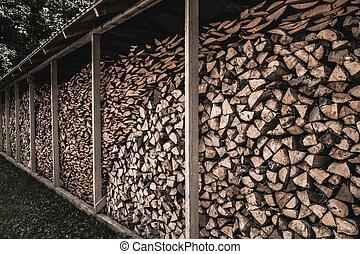 Stockpile of sawed logs under shed