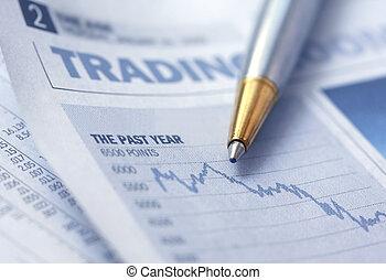 Stocks Graph and Pen - Pen over depressing newspaper stocks...