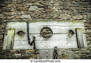 Stocks - Detail of wooden medieval stocks used to...