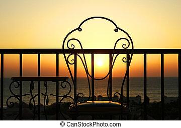 stoelen, ondergaande zon , silhouette
