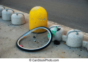 Stolen Bicycle - Remaining Wheel of a stolen Bicycle in a...