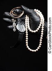 Stolen goods. Close-up of hand in gloves holding stolen...