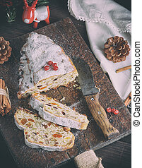 Stollen baked traditional European cake with nuts and candied fruits