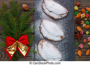 Stollen. Mini Stollen. Traditional Christmas cake with nuts, raisins and candied fruit