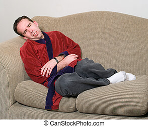 Stomach Pains - Young man clenching because he is feeling...