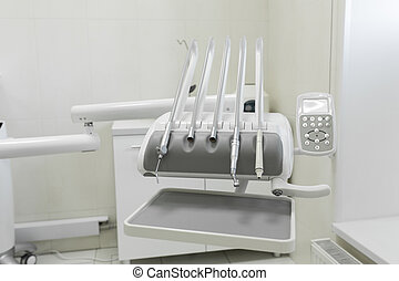 Stomatological instrument in the dentists clinic. Dental background: work in clinic operation, tooth replacement.