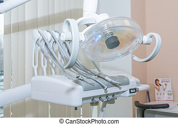 Stomatological instrument in the dentists clinic. Dental background: work in clinic, tooth replacement.dental equipment such as drills in dentist's surgery