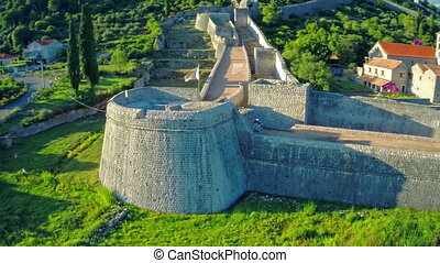 Ston walls tower Arcimun - Copter aerial view of the...