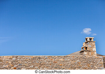 Stone amde chimney on roof
