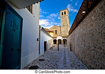 Stone ancient Italian street and church in Cividale del...