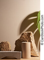 Stone and a piece of tile podium on a beige background