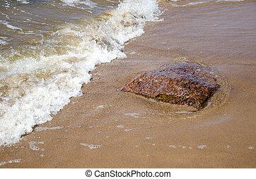 stone and sea wave on beach