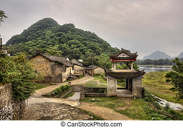 Stone arbor pagoda at entrance - Fuli Village, Yangshuo,...