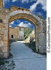 stone arch in San Pedro de Arlanza in the province of Burgos, Spain