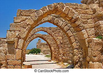 Stone arches. - National park Caesarea on coast of ...