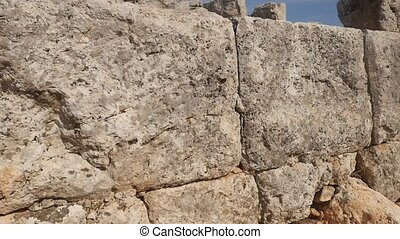 Stone background. An old stone texture wall in the ancient greek city Lyrboton