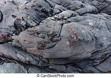 Stone background of the coast in India