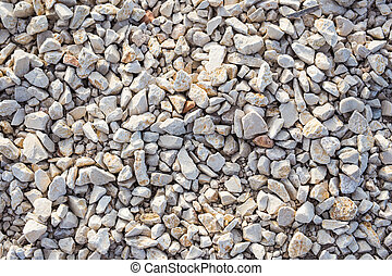 Stone background texture on the beach, top view