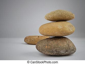 stone balance on gray background
