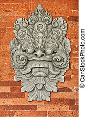 Stone bas-relief on the brick wall. Indonesia, Bali.