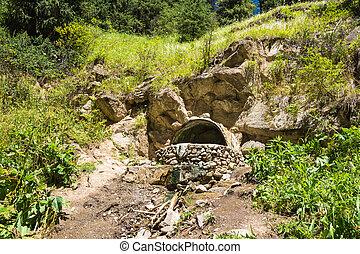 Stone bath with hot mineral water in Altyn Arashan, Kyrgyzstan.
