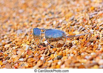 stone beach and sun glasses