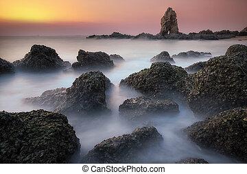 Stone beach and sunset
