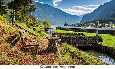 Stone bench at the mountain river