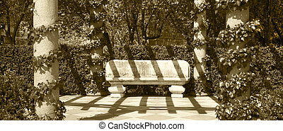 Stone bench in a park. Sepia tone