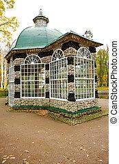 Stone bird house in the park