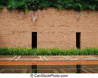 stone block wall ,garden and water