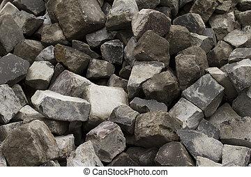 stone blocks lying in the street