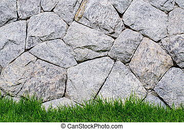 Stone Brick wall and green grass