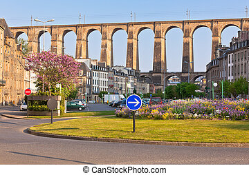Large stone bridge in Morlaix town, Brittany, France at sunny evening