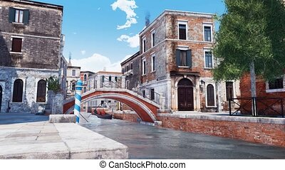 Stone bridge over narrow water canal in Venice - Old stone...