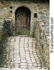 Stone bridge up to manor house door