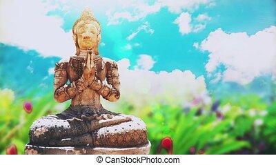 Stone Buddha Statue in green garden