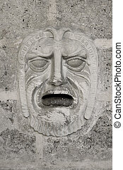 Stone carved face mail box