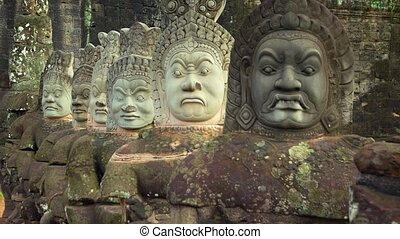 Stone carved statues on the bridge to Angkor Thom. Siem Reap, Cambodia. Video UltraHD 4k