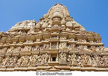 Stone carved temple in Khajuraho, Madhya Pradesh, India -...