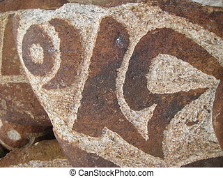 stone carved with symbols of prosperity 15