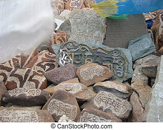 stone carved with symbols of prosperity 17