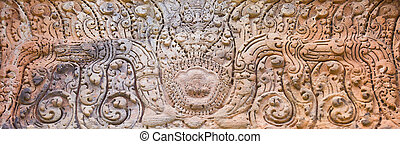 Stone carving of ancient Khmer art.