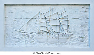 Stone carving of Chinese junk on temple wall