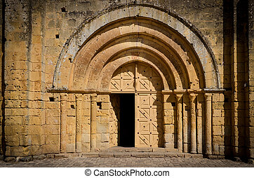 Stone church entrance door and arcs, St Emilion, France