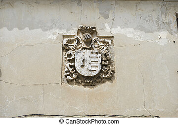 Stone coat of arms on the facade of an old building