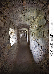 stone corridors in the ruins of an ancient castle