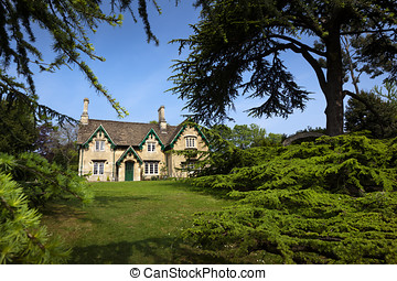 Stone Cottage and Trees - Rustic stone cottage with ornate...